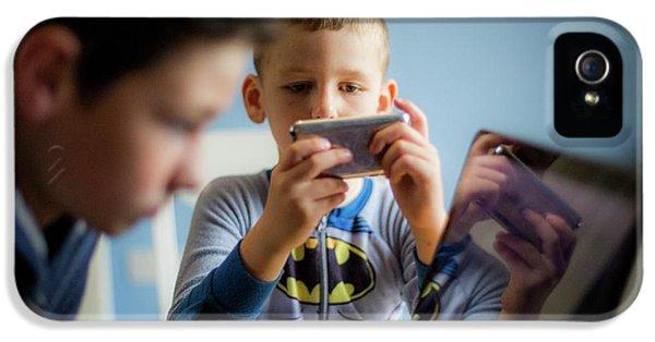 Boy Using Smartphone IPhone 5 Case by Samuel Ashfield