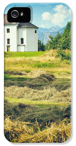 IPhone 5 Case featuring the photograph Country Church With Hay by Silvia Ganora