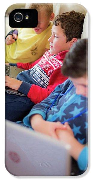 Three Boys Using Laptops Sitting On Sofa IPhone 5 Case