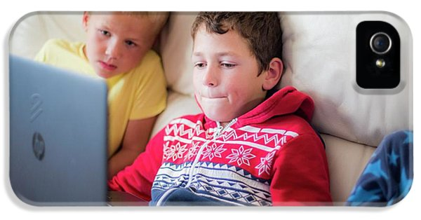 Two Boys Using A Laptop Sitting On Sofa IPhone 5 Case
