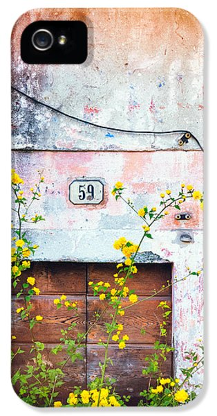 IPhone 5 Case featuring the photograph Yellow Flowers And Decayed Wall by Silvia Ganora
