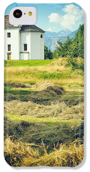 IPhone 5c Case featuring the photograph Country Church With Hay by Silvia Ganora