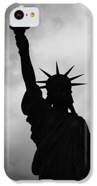 IPhone 5c Case featuring the photograph Statue Of Liberty Silhouette by Dave Beckerman