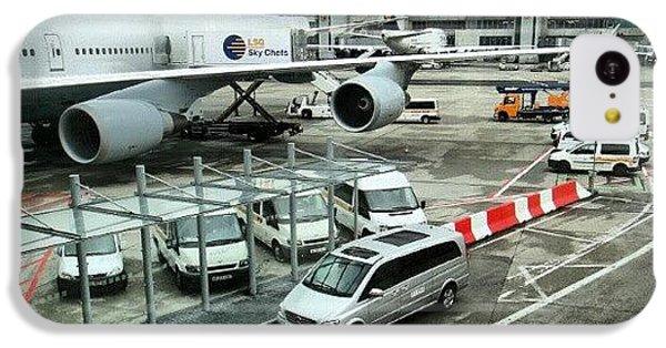Follow iPhone 5c Case - #airport #manchester #plane #car #cloudy by Abdelrahman Alawwad