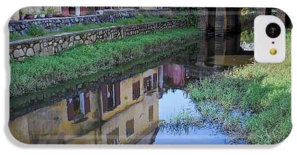 IPhone 5c Case featuring the photograph Chua Cau Reflection by Hitendra SINKAR