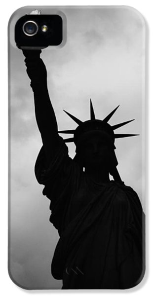 IPhone 5s Case featuring the photograph Statue Of Liberty Silhouette by Dave Beckerman