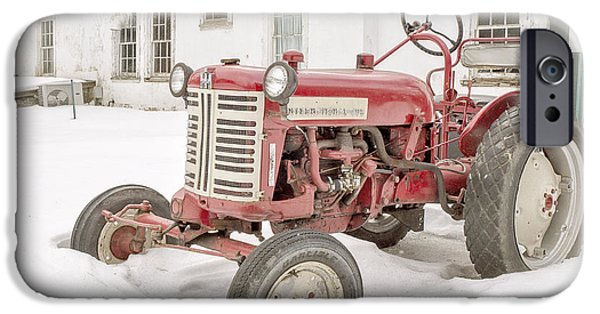 Winter Storm iPhone Cases - Old Red Tractor in the snow iPhone Case by Edward Fielding