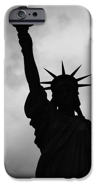 IPhone 6 Case featuring the photograph Statue Of Liberty Silhouette by Dave Beckerman