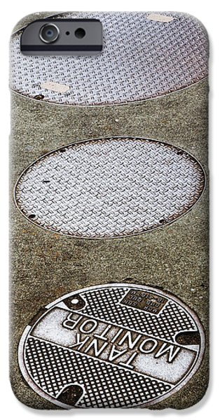 2d iPhone Cases -  Round Metallic Covering In Road iPhone Case by Nathan Griffith