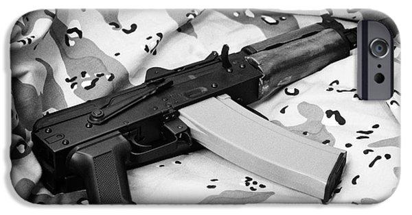 Weapon iPhone Cases - Ak-47u On Old Persian Gulf War Desert Battle Dress Uniform iPhone Case by Joe Fox