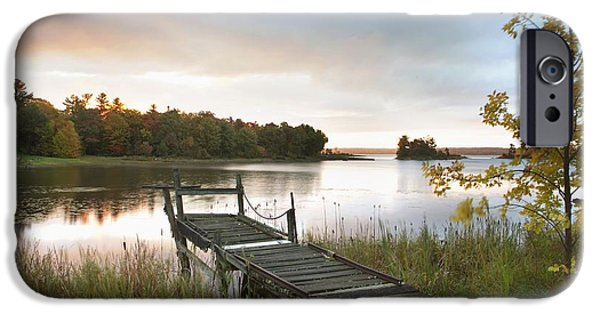 Twilight iPhone Cases - A Dock On A Lake At Sunrise Near Wawa iPhone Case by Susan Dykstra