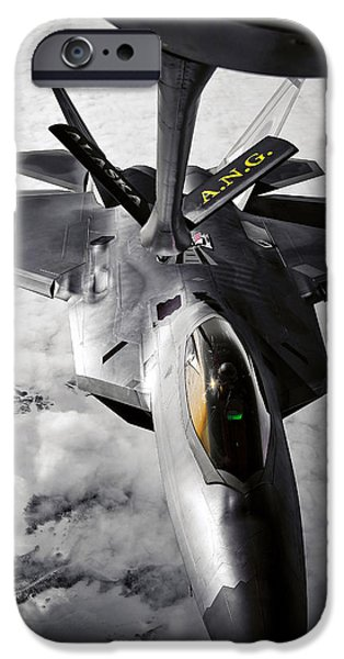 Mechanism iPhone Cases - A Kc-135 Stratotanker Refuels A F-22 iPhone Case by Stocktrek Images