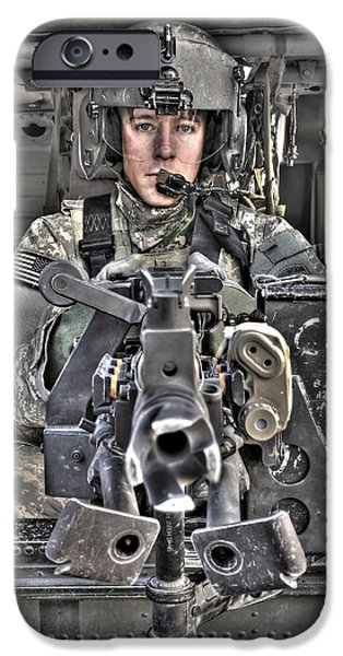 Iraq iPhone Cases - A Uh-60 Black Hawk Door Gunner Manning iPhone Case by Terry Moore