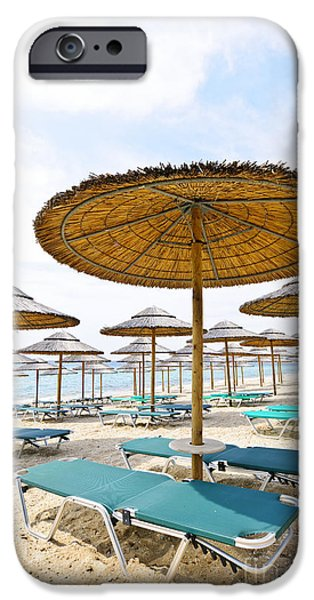 Empty Chairs iPhone Cases - Beach umbrellas and chairs on sandy seashore iPhone Case by Elena Elisseeva