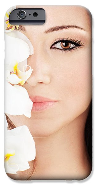Young Photographs iPhone Cases - Closeup on beautiful face with flowers iPhone Case by Anna Omelchenko