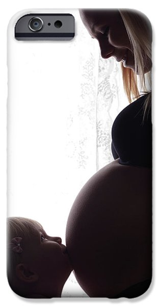 Women Together iPhone Cases - Daughter Kissing Her Pregnant Mothers Belly iPhone Case by Oleksiy Maksymenko