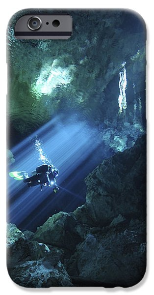 Cavern iPhone Cases - Diver Silhouetted In Sunrays Of Cenote iPhone Case by Karen Doody