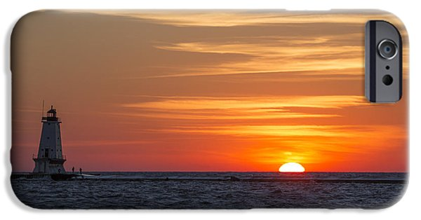 IPhone 6 Case featuring the photograph Ludington North Breakwater Light At Sunset by Adam Romanowicz