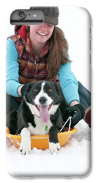 Knit Hat iPhone 6 Plus Case - A Smiling Young Woman Rides A Sled by Jeff Diener