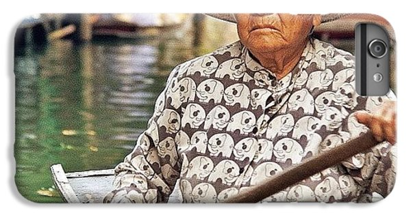 An Elderly Lady Rowing Along The IPhone 6 Plus Case