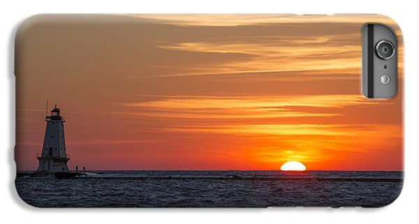 IPhone 6 Plus Case featuring the photograph Ludington North Breakwater Light At Sunset by Adam Romanowicz