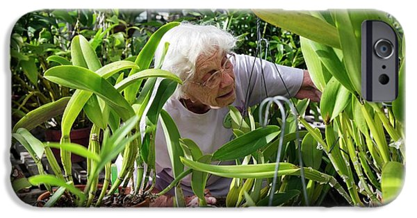 Elderly Woman Examining Plants IPhone 6s Case by Jim West