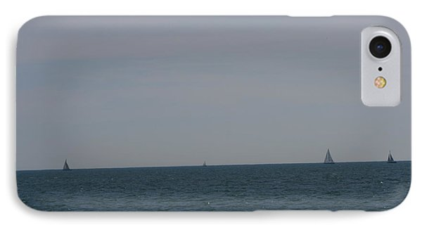 IPhone Case featuring the photograph  Four Yachts At Sea by Phoenix De Vries