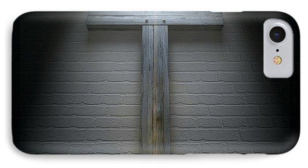 Crucifix On A Wall Under Spotlight IPhone Case by Allan Swart