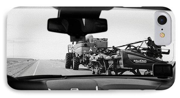 driving behind combine harvester on road in Saskatchewan Canada IPhone Case by Joe Fox