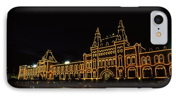 Facade Of A Building Lit Up At Night IPhone Case by Panoramic Images