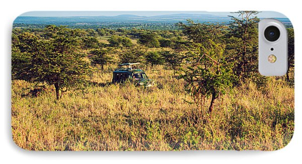 Jeep With Tourists On Safari In Serengeti. Tanzania. Africa. Phone Case by Michal Bednarek