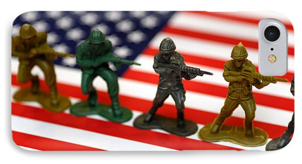 Line Of Toy Soldiers On American Flag Shallow Depth Of Field IPhone Case by Amy Cicconi