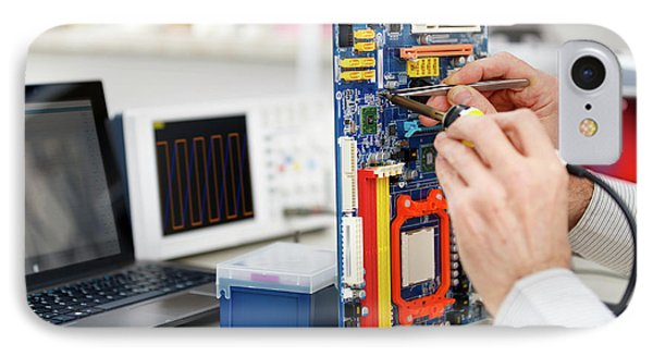 Person Repairing Electronic Circuit Board IPhone Case by Wladimir Bulgar