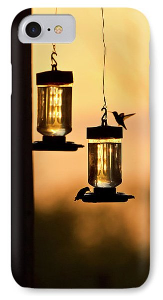 Hummingbirds At Feeder Before Sunrise IPhone Case by Larry Ditto