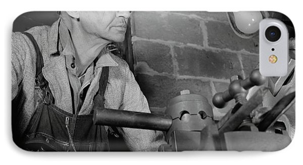 Man Working In A Small Machine Shop IPhone Case by Stocktrek Images
