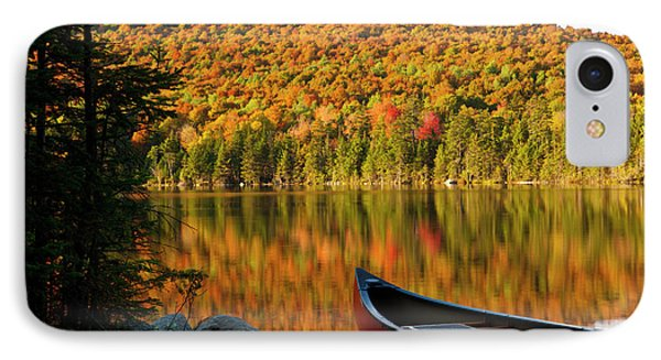 A Canoe On The Shoreline Of Pond IPhone Case