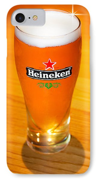 A Cold Refreshing Pint Of Heineken Lager IPhone Case by Semmick Photo