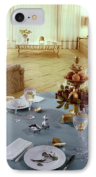 A Dining Room With A Blue Tablecloth And Ornate IPhone Case by Wiliam Grigsby