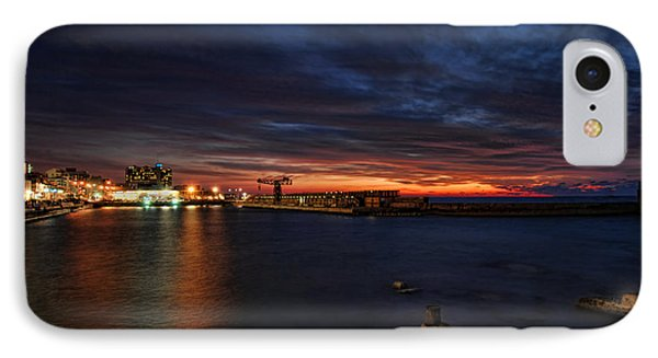IPhone Case featuring the photograph a flaming sunset at Tel Aviv port by Ron Shoshani