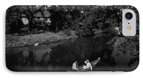 A Man And Woman In A Canoe On A Lake IPhone Case by Roger Sturtevant