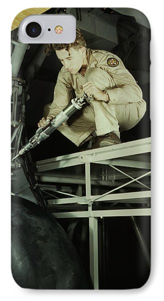 A Mechanic Greasing The Landing Gear IPhone Case by Stocktrek Images