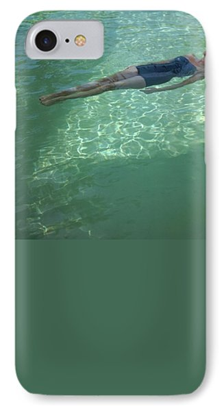 A Model Floating In A Swimming Pool IPhone Case by John Rawlings