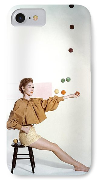 A Model Sitting On A Stool Juggling IPhone Case by John Rawlings