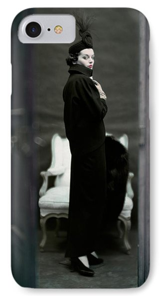 A Model Wearing An Adele Simpsons Ensemble IPhone Case by John Rawlings