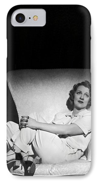 A Pensive Woman Curled Up In A Chair IPhone Case by Underwood Archives