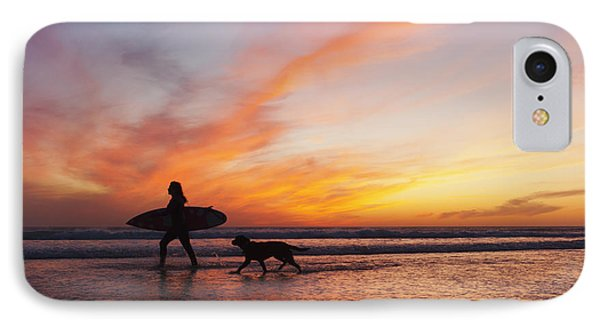 A Surfer Walks In Shallow Water With IPhone Case by Ben Welsh