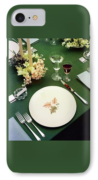 A Table Setting On A Green Tablecloth IPhone Case