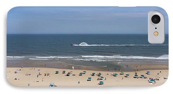 A Touring Speedboat Passes By Shore In Ocean City Maryland IPhone Case by William Kuta