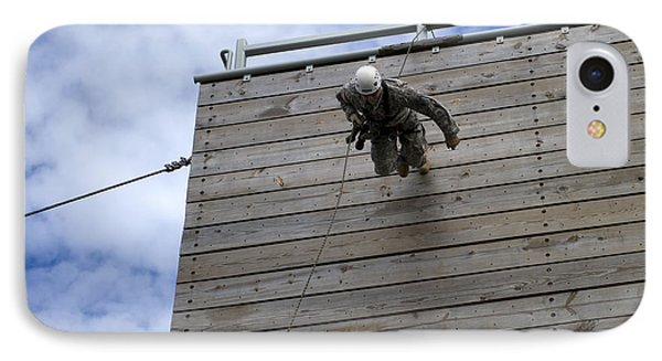 A U.s. Soldier Runs Down A 40-foot Phone Case by Stocktrek Images