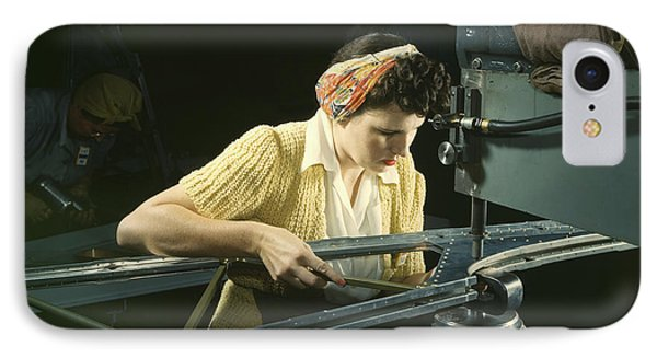 A Woman Riveting Machine Operator At An IPhone Case by Stocktrek Images